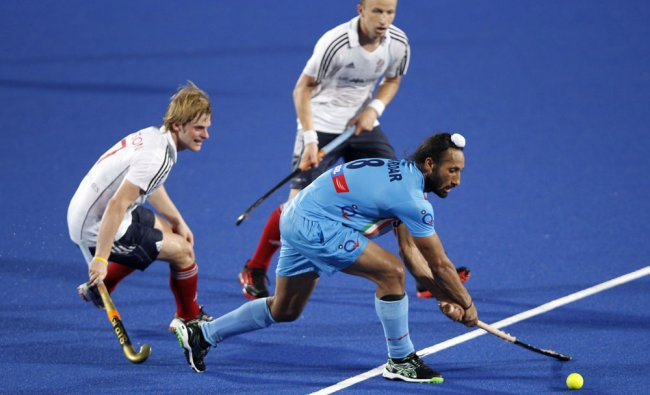 India\'s Singh Sardar controls the ball against Britain\'s Ashley Jackson during 3rd place playoff ...