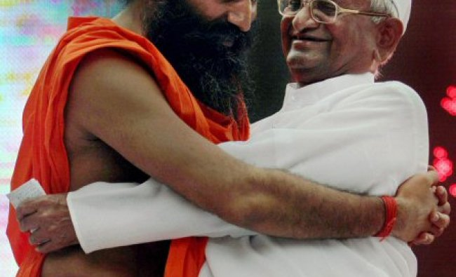 Anna Hazare with Baba Ramdev during the day long fast called by Ramdev in New Delhi