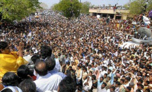 YSR Congress Party honorary president Y.S. Vijayamma (2L) addresses a crowd during a public meeting