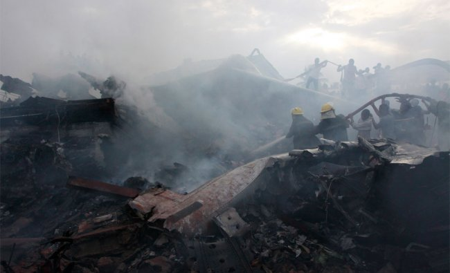 Rescue workers search for survivors at the site of a plane crash in Lagos