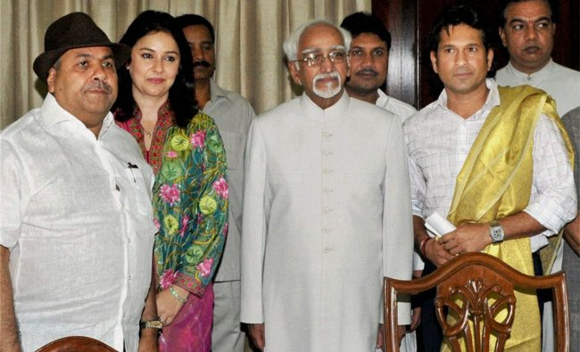 Vice President Hamid Ansari with Sachin Tendulkar and his wife Anjali after the cricketer took oath