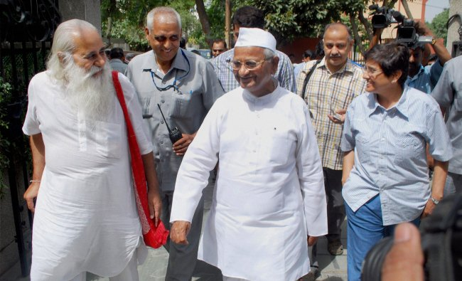 Social activist Anna Hazare and his team arrive for their core commtiee meeting in Noida