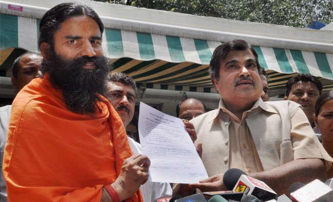 BJP National President Nitin Gadkari with Yog Guru Baba Ramdev interacting with the media after...