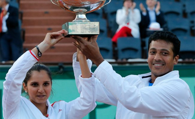 Sania Mirza and Mahesh Bhupathi hold the trophy after winning the mixed doubles final