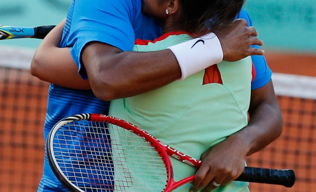 Sania Mirza and Mahesh Bhupathi hug after winning their mixed doubles final match of French Open