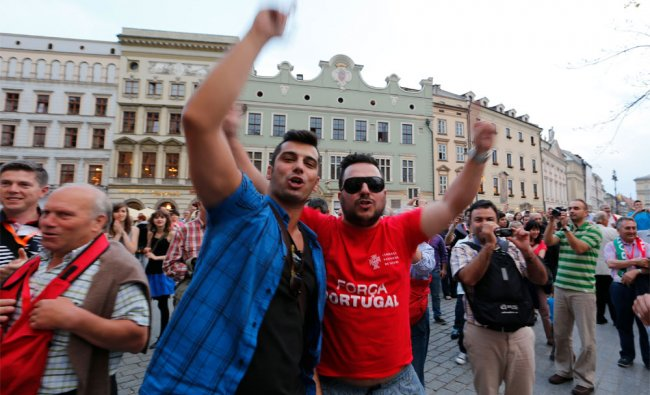 Portuguese soccer fans gather in the market place in Krakow, Poland