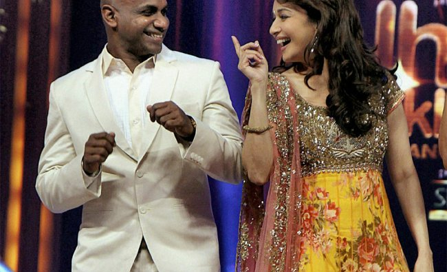 Sanath Jayasuriya (L) with actress Madhuri Dixit performs during the launch of a TV reality show