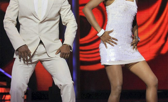 Sanath Jayasuriya performs during the launch of a TV reality show