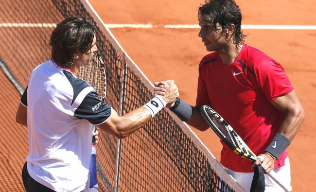Rafael Nadal (R) reacts after wining over Spain\'s David Ferrer (L) at the French Open