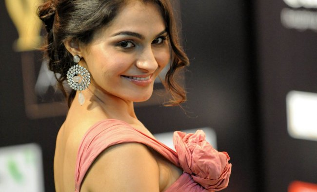 Bollywood actress Andrea Jeremiah poses on the green carpet