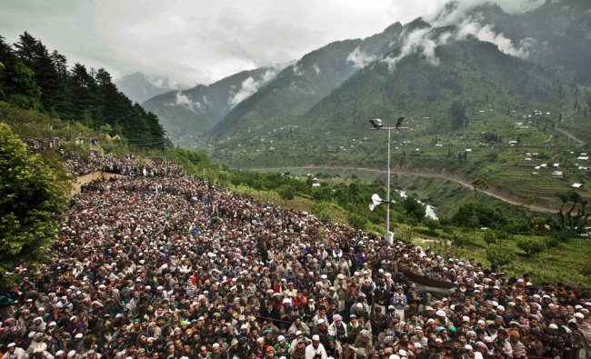 Kashmiri Muslims belonging to nomadic Gujjar tribe pray at a forest shrine of Miyan Peer, Srinagar..