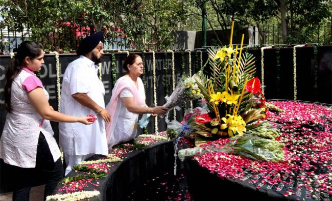 Relatives of the victims of Uphaar fire tragedy paying tributes at a memorial