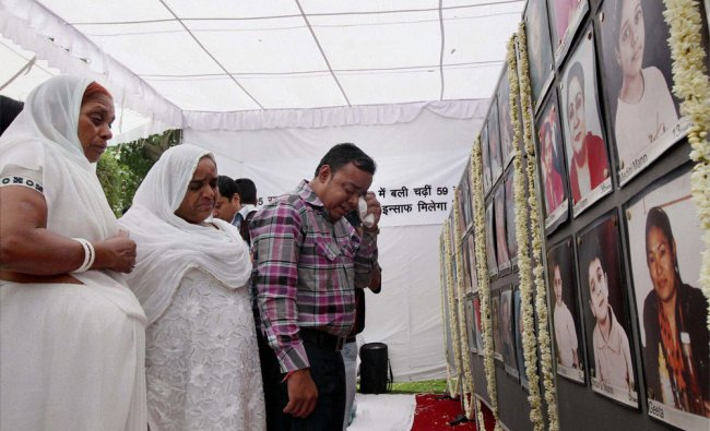 Relatives of the Uphaar fire tragedy victims during a prayer meeting near the cinema hall