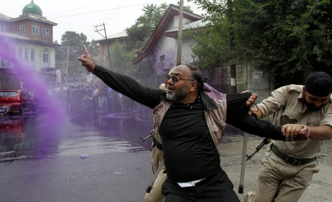Police use colored water to disperse Kashmiri government employees