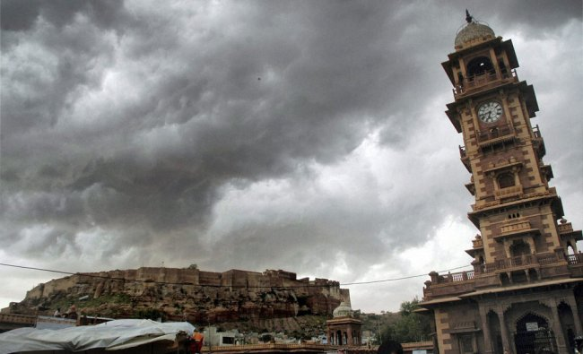 Dark clouds gather over Mehrangarh fort and clock tower in Jodhpur on Wednesday...