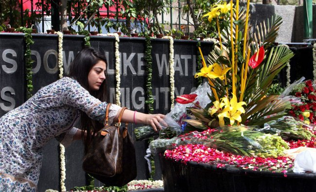 A relative paying tributes to Uphaar fire tragedy victims at a memorial at it\'s 15 th anniversary