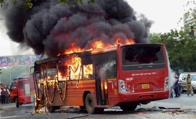 A passenger bus catches fire after an accident in Ahmedabad...