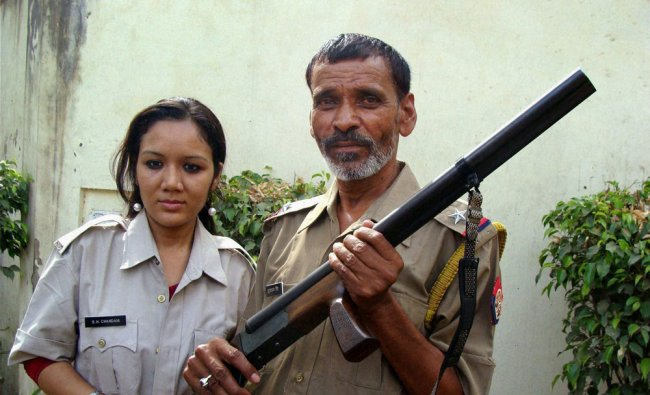 Real-life dacoit Maan Singh and actress Deepika pose for the promotion of their movie...