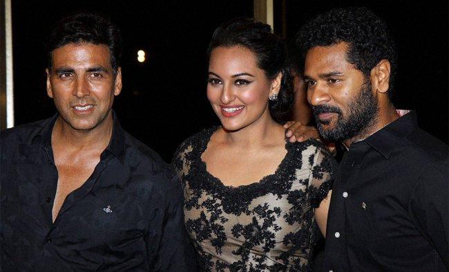 Actors Akshay Kumar, Sonakshi Sinha and director Prabhu Deva of film Rowdy Rathore during a party