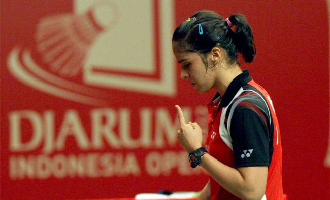 Saina Nehwal of India reacts after scoring a point against China\'s Li Xuerui