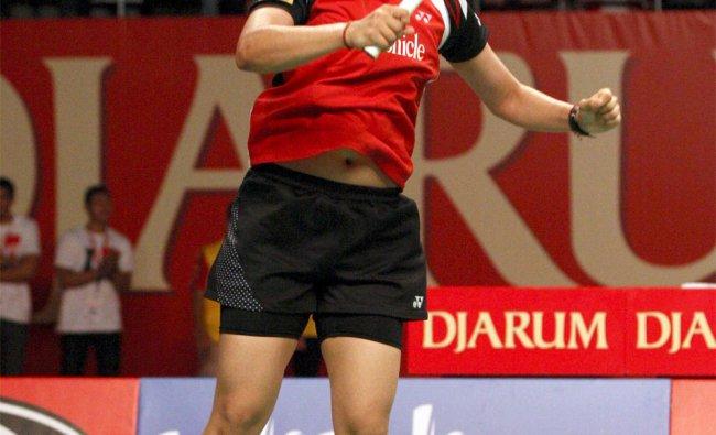 Saina Nehwal celebrates upon defeating China\'s Li Xuerui in their women\'s singles final match