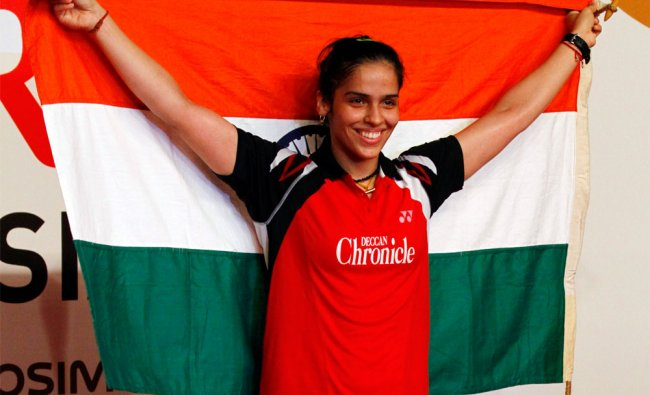 Saina Nehwal waves the national flag after winning the Indonesia Open