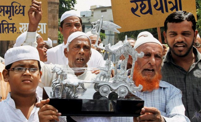 Muslims carry silver chariot to be presented to head priest of Lord Jagganathji Temple