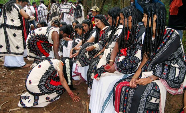 Members of Toda tribal community during a Marriage in Fernhill mund near Ooty