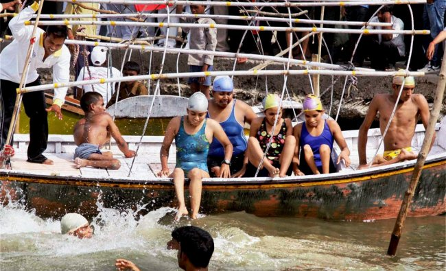 Participants during the 3rd Open water All India Physically challenged swimming competition