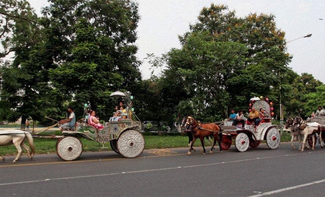 Tourists enjoy the horse cart ride in Kolkata