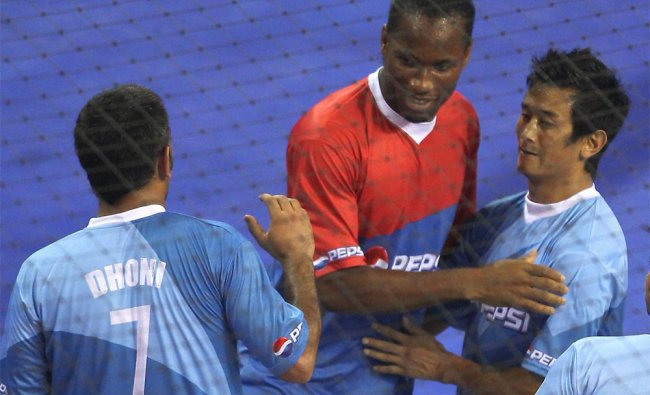 Didier Drogba, cricketer MS Dhoni and soccer player Baichung Bhutia during an exhibition