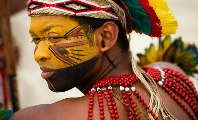 A Pataxo Indian waits to participate in the building of a human banner on Flamengo beach
