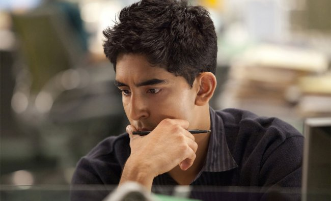 This publicity image released by HBO shows Dev Patel portraying Neal on the HBO series,The Newsroom