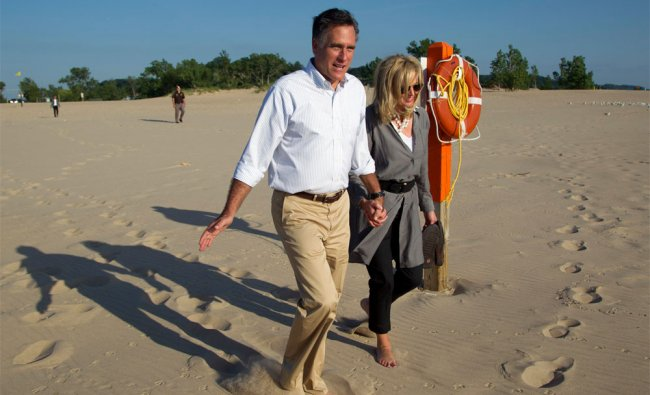 Mitt Romney takes a walk with his wife Ann, on the beach after a campaign stop at Holland State Park