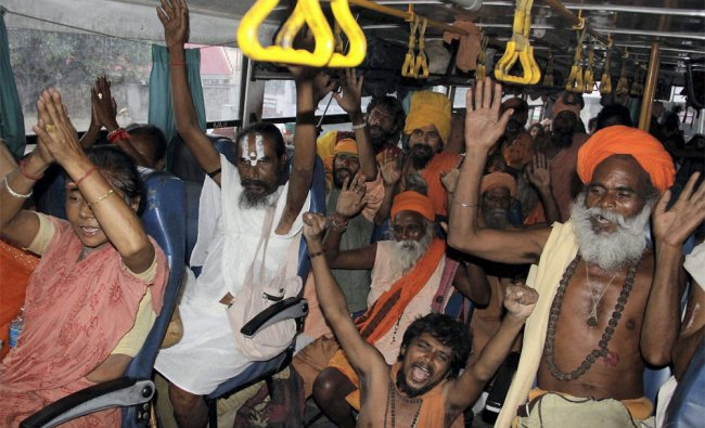 Sadhus shout religious slogans as they leave for Amarnath yatra, in Jammu