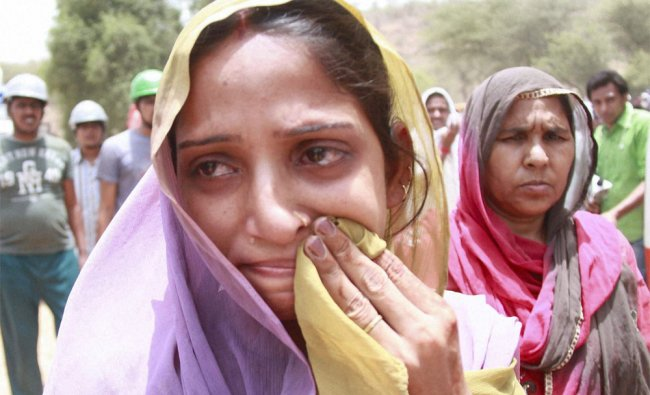 Wailing mother of four-year-old Mahi who was pulled out dead from a borewell