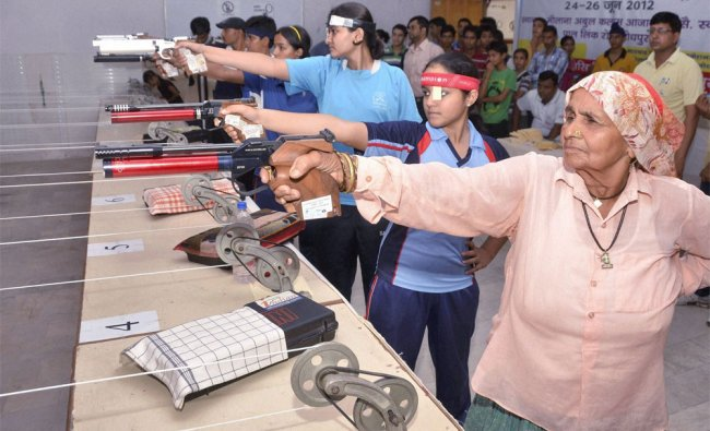 78-year-old Chando Tomar from Bagpat participates in a rifile shooting competition in Jodhpur