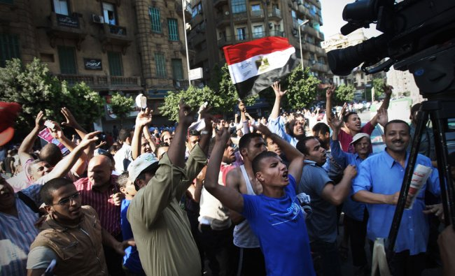 Egyptian protesters celebrate the victory of Mohammed Morsi of the presidential election Egypt...