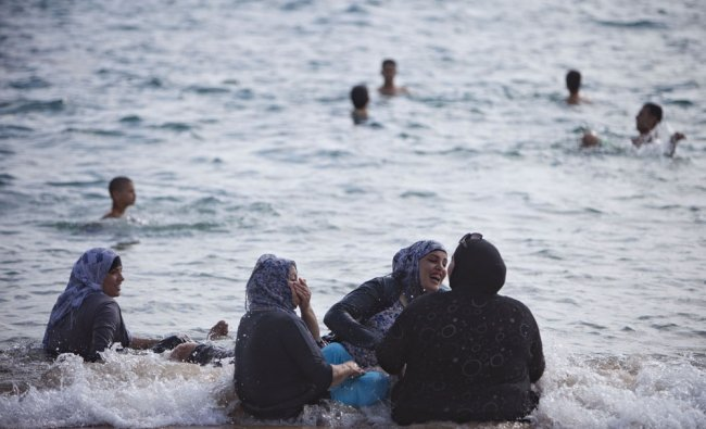 Israeli Arabs enjoy the beach in Jaffa, a mixed Jewish and Arab part of Israel...