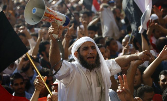 Egyptian protesters celebrate the victory of Mohammed Morsi, Tahrir Square...