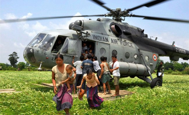 An Indian Air Force helicopter shifting people of the flood-affected villages in Arunachal