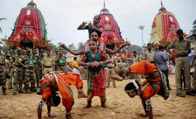 Gotipua dancers perform in front of the chariots of Jagannath