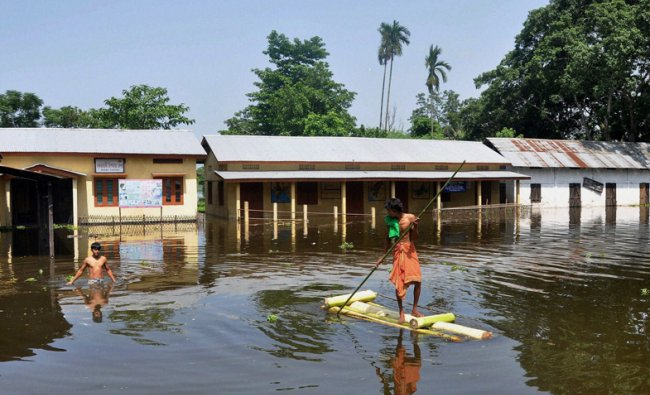 A government school and a public health dispensary submerged by flood waters