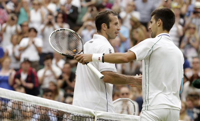 Novak Djokovic is congratulated by Radek Stepanek of the Czech Republic in third round men\'s single