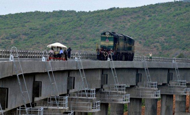A train engine during a trial run at the new Kadur- Chikmagalur railway line in Karnataka ...