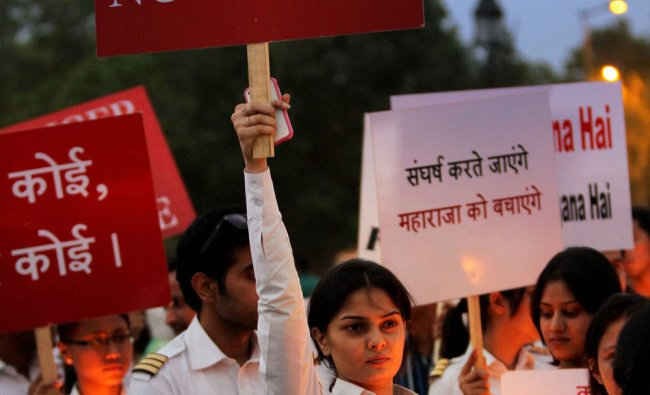 Air India pilots take out a candle light procession on the sixth day of their hunger strike...