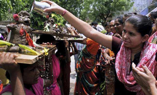 Hindu women perform special prayers for rains in Ahmedabad...