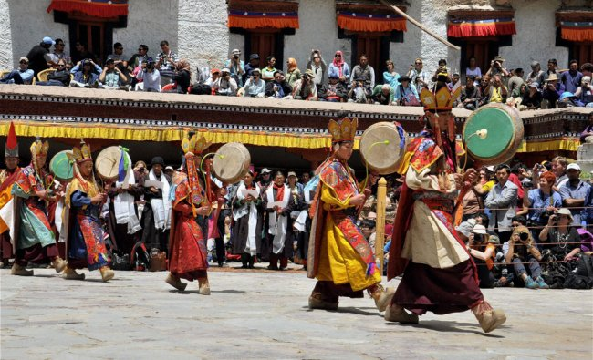 Monks dance with pipe drums at the Hemis Festival near Leh...