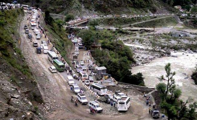 Vehicles stranded in mud on a highway after cloud burst and heavy rains in Uttarkashi