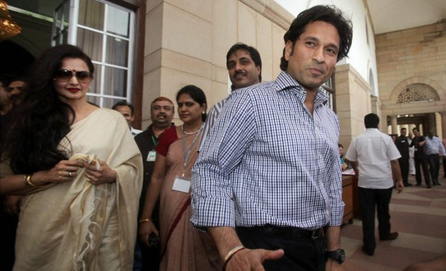 Sachin Tendulkar and actress-MP Rekha leave after casting their votes for the election...